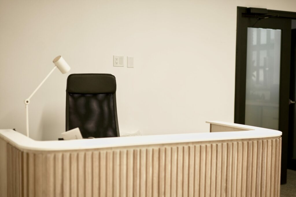 A reception desk with a empty chair