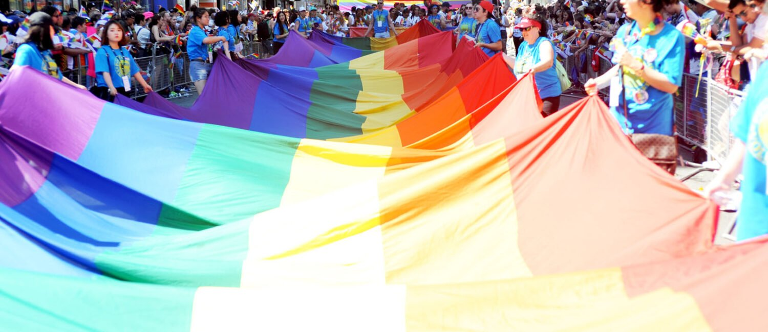 The Pride flag being walked through the parade.