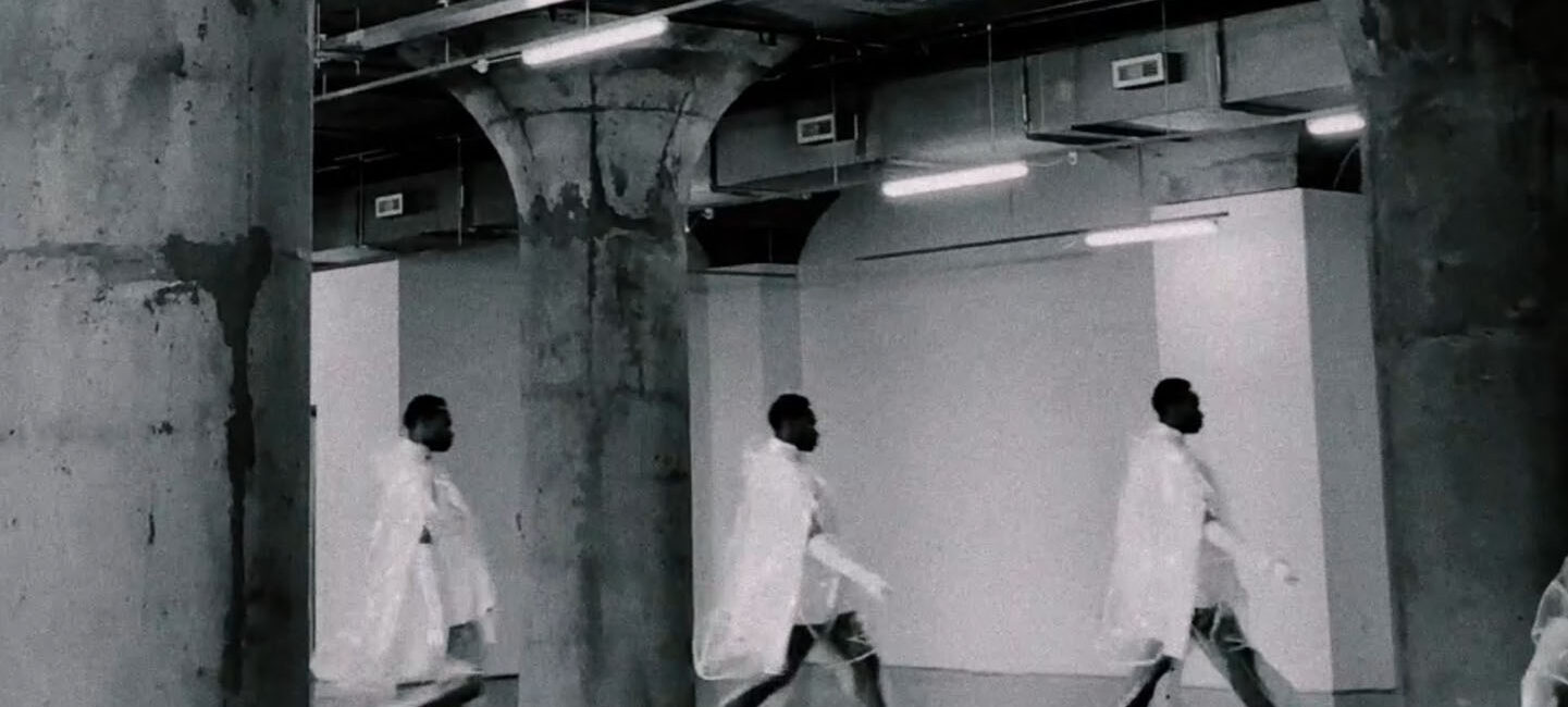 People walking to the right in a warehouse