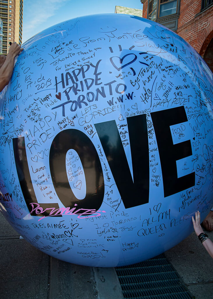 A big plastic ball with the word 'love' on it.