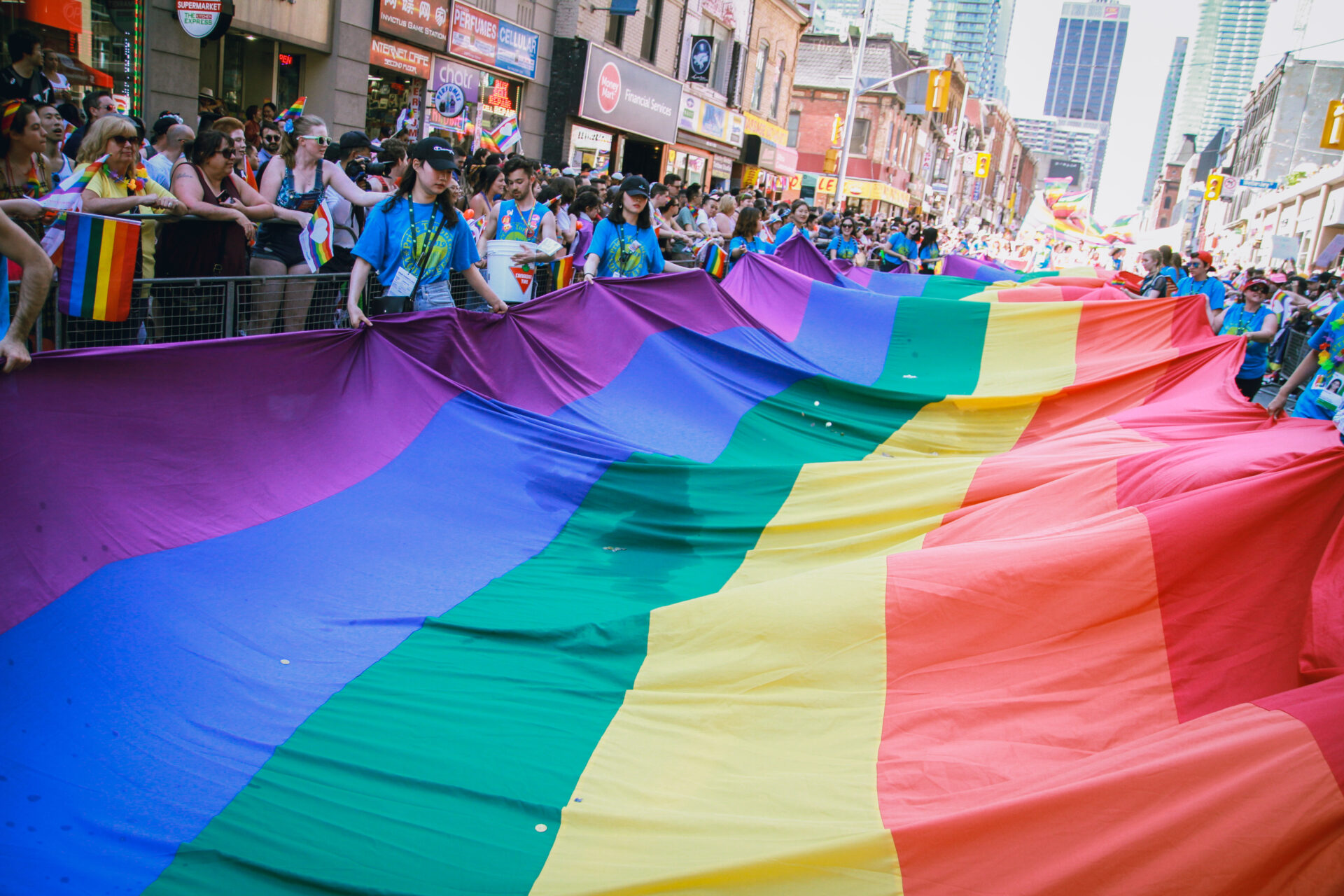The Pride Flag being walked through the parade