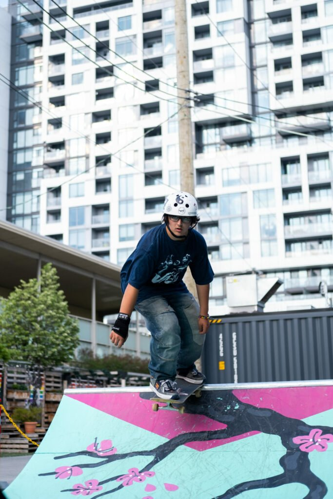 a skateboarder about to set off from the top of the ramp