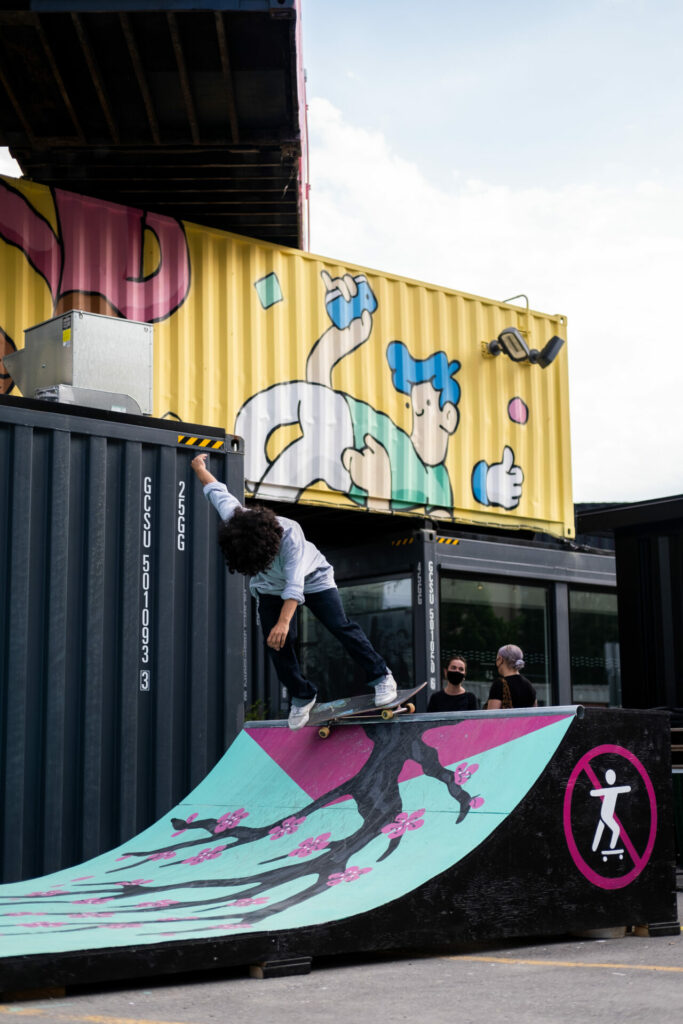 a skateboarder on the top of the ramp