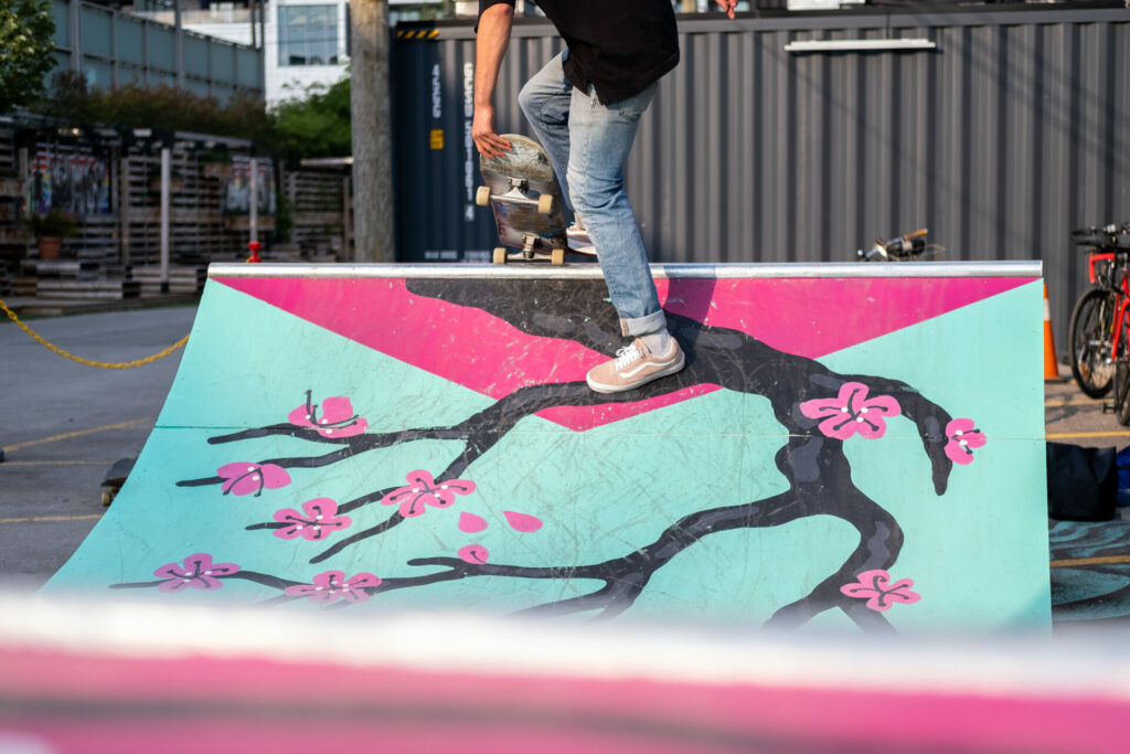A skaterboarder setting off from the top of the ramp