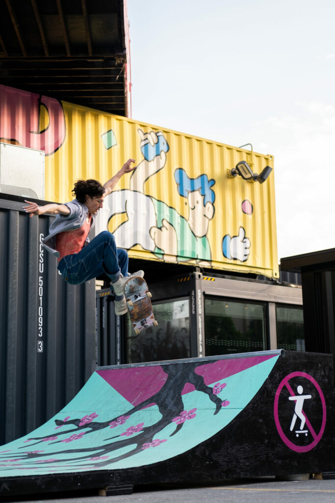 a skateboarder on the top of the ramp doing a trick