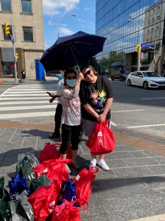 Pedestrians with pride bags