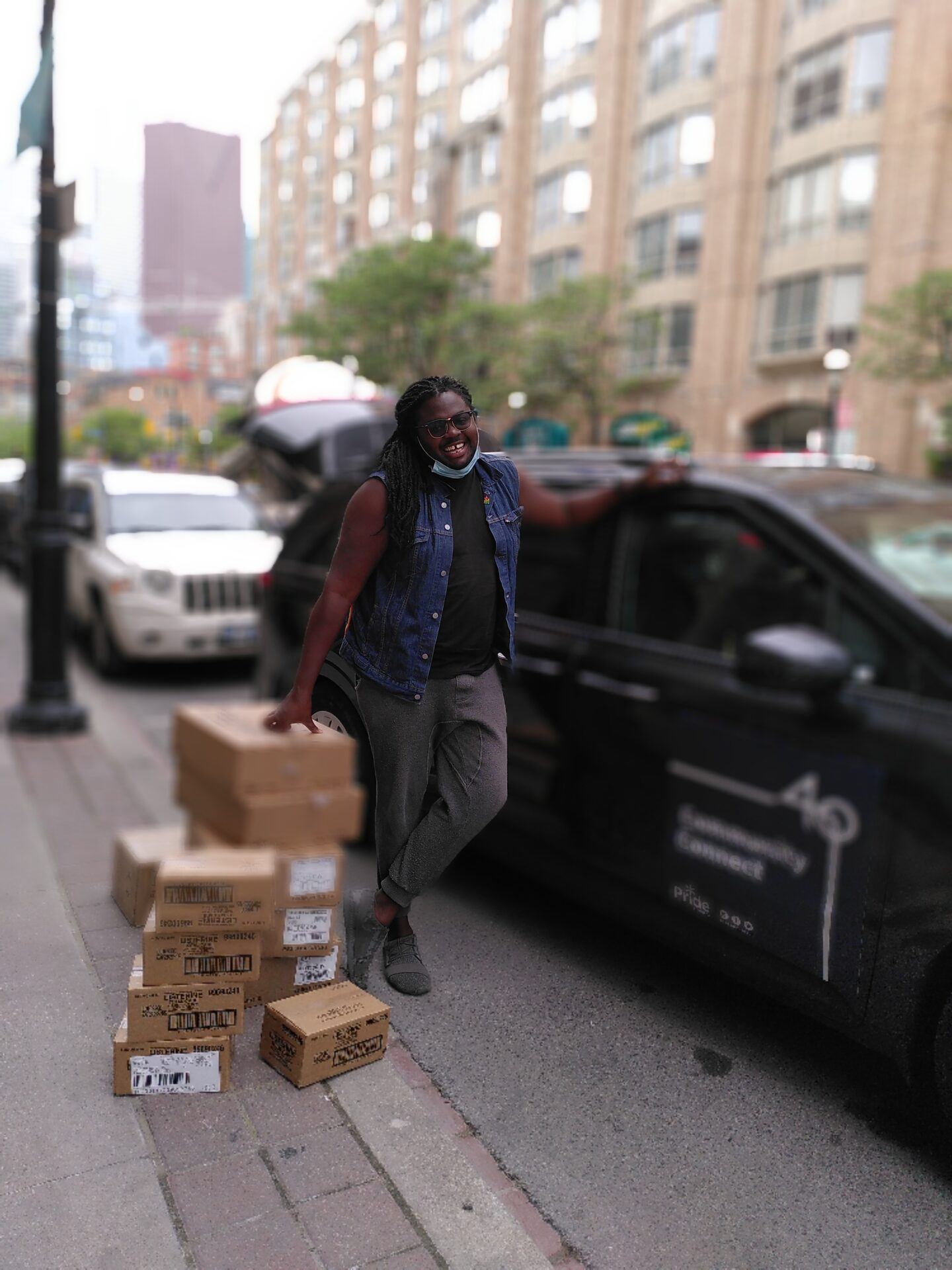Nicoy (Community Engagement & Office Manager) with boxes of donations